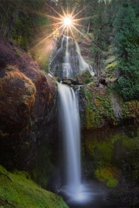 Shining light above waterfall